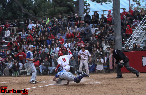Burroughs' Ryan Galan slides in safely at the plate just before the tag by Jake Noud of Burbank (Photo by Ross A. Benson)