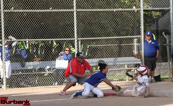 The Burroughs Indians slid safely by the Lady Bulldogs to capture a share of the league title (Photo by Ross A. Benson)