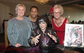 """Ann O'Donnell-Gardner, center, uses her crystal ball to channel Harry Houdini during La Providencia Guild's """"That Old Black Magic"""" gala at the Castaway. She's surrounded by members, from left, Lorelei Kelley, Glenda Jones and Lynn White-Shelby."""
