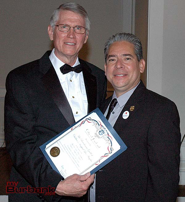 Burbank Mayor Bob Frutos, right, presents a city proclamation to master of ceremonies Brooks Gardner, who accepts the honor for all the women of La Providencia Guild of Los Angeles Children's Hospital. (Photo by Joyce Rudolph)