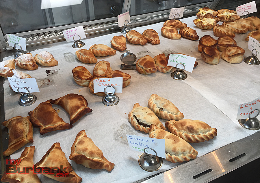 Savory and sweet empanadas fill World Empanadas display case. (Photo By Lisa Paredes)