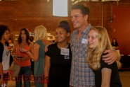 Actor and Director Bart Johnson poses for a photo with some fans at the Secret Art Show on Saturday. Photo by: Edward Tovmassian