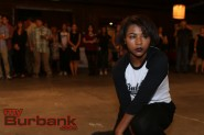 "Joya Jackson holds a pose during the ""flash mob"" performance put on by the BHS dance team Unleashed at the Secret Art Show Saturday. Photo by: Edward Tovmassian"