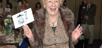 Irene Metzger models several items from the La Providencia Guild thrift shop benefiting Children's Hospital Los Angeles.