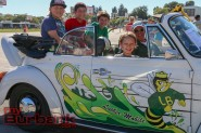 """Mr.Joe Reed and his """"Rusty Restorations"""" club members sit in the """"Luther Mobile"""" at Luther Burbank Middle School on Friday for the Luther Beach Party. Photo By: Edward Tovmassian"""