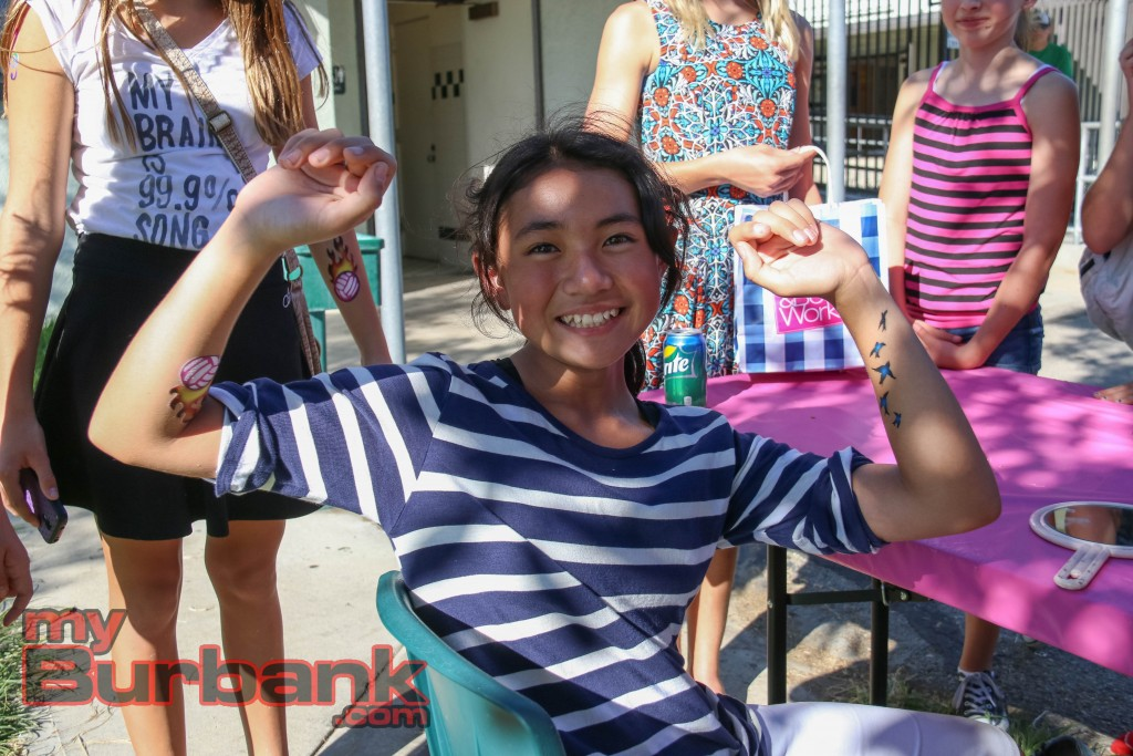 Sophia Almaraz shows off her air brush tattoos at Luther Burbank Middle School on friday during the Luther Beach Party. Photo By: Edward Tovmassian