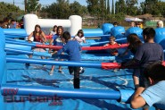 Students and family members enjoy a game of life sized Foos Ball at Luther Burbank Middle School on Friday during the Luther Beach Party. Photo By: Edward Tovmassian