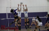 Melissa Daniel, and Nicole Winters jump up to block a spike by Hoover at Hoover High School in Glendale Calif. on Tuesday. Photo By: Edward Tovmassian
