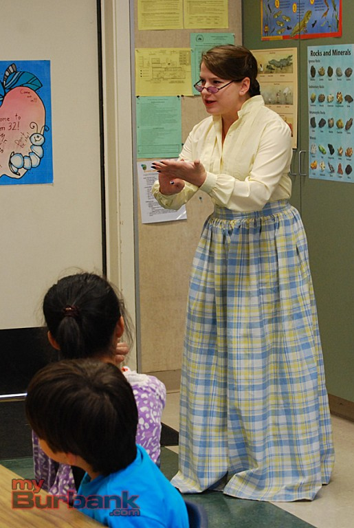 Helen Keller's teacher Annie Sullivan, acted by Maddie Seiffert, talks to second-graders at McKinley. (Photo By Lisa Paredes)