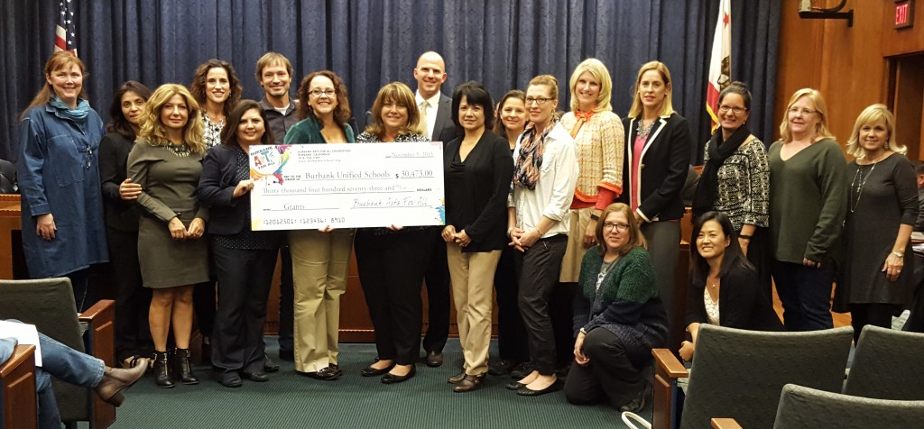 Burbank Arts For All Foundation Board of Directors members and Executive Director present a check for $30,473 to the BUSD Board of Education. BUSD Superintendent Matt Hill, District Administrative staff, BUSD teachers, principals and parent leaders gather for the presentation on November 5, 2015. (Photo Courtesy Burbank Arts For All Foundation)