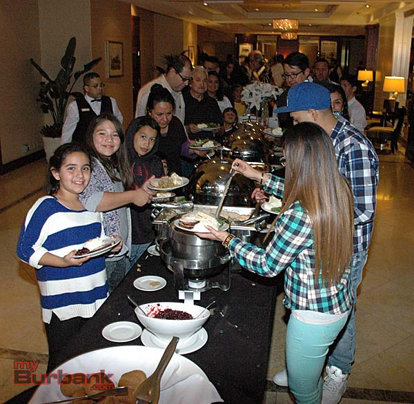 Boys & Girls Club members Alicia Perez, left, and Alexa Medina, fill their plates with turkey and all the fixings at the Los Angeles Marriott Burbank Airport. (Photos by Joyce Rudolph)