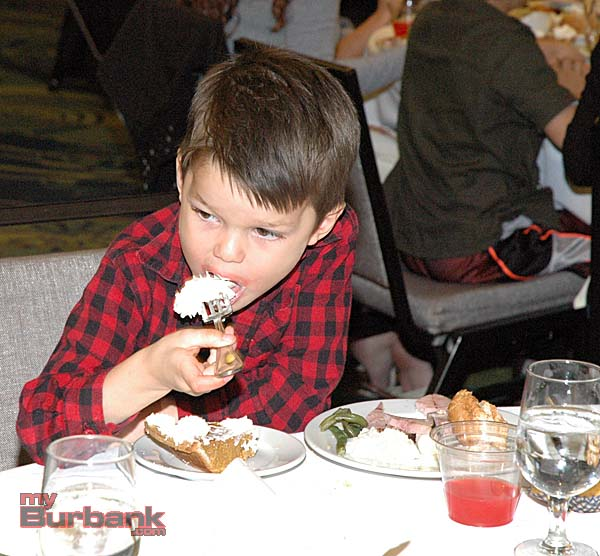 Dean Herman, 4, is more interested in the whipped cream on his pumpkin pie than the ham on his plate