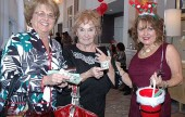 Guests Donna Thill, from left, and Joanne Adams purchase opportunity tickets from La Providencia Guild member Carrie McCoy.