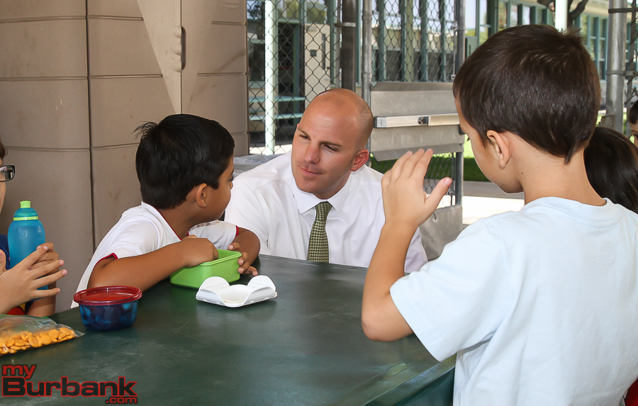 Superintendent Matt Hill talks with BUSD elementary school kids on the first day of school, August 17, 2015.  (Photo by © Ross A. Benson)