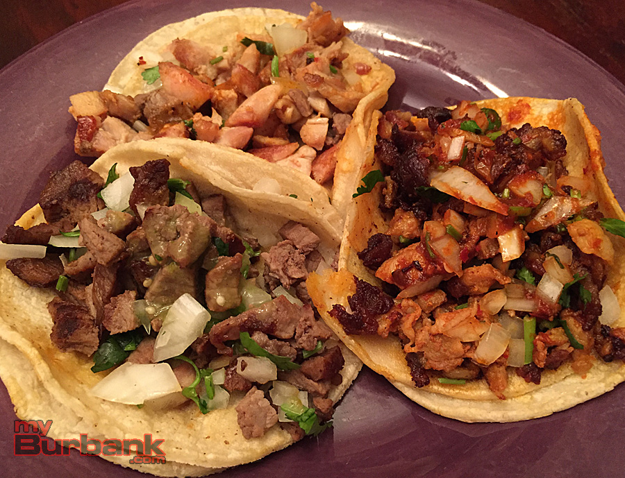 A trio of amazing taco from Taqueria El Tapatio - (clockwise from bottom left) carne asada, chicken and al pastor. (Photo By Lisa Paredes)