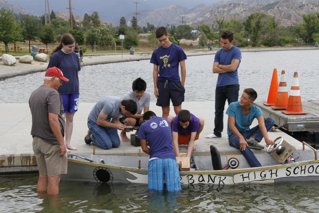 Students working on the boat this past Sunday.