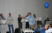 "Director Bill Kuzma leads the alumni members in the group's signature song ""South Rampart Street Parade"". (Courtesy Joanne Lento Miller)"