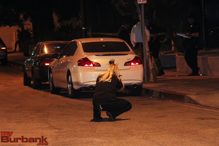 Burbank Police Forensics Specialist takes pictures of shell casings prior to recovering them. ( Photo by © Ross A. Benson)