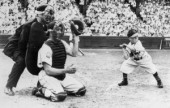 FILE PHOTO AUGUST 19, 1951 -- Eddie Gaedel, a 3-foot-7 inch person, takes his famous at-bat on Aug. 19, 1951 for Bill Veeck's St. Louis Browns.  The catcher is Detroit's Bob Swift, and the umpire is Ed Hurley.
