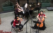 """Violinist Jessica Park, pianist Maya Paredes and cellist Claire Park - Trio Épicé from The Colburn School - perform Ravel's """"Trio in a minor."""" (Photo by © Ross A Benson)"""