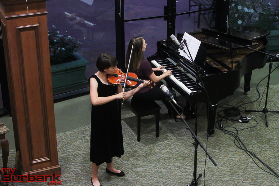 "Eyén Paredes and Maya Paredes play ""Libertango"" by Astor Piazzolla for violin and piano. (Photo by © Ross A Benson)"
