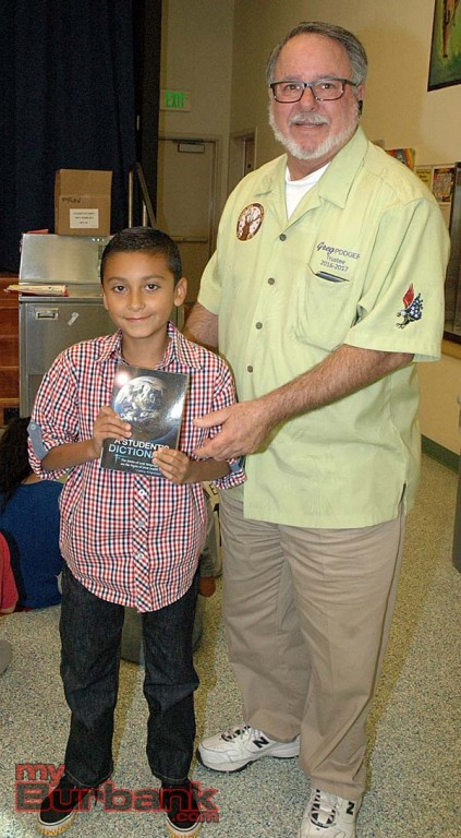 Cesar Lopez, 8, a third-grader at Providencia Elementary School, shows his dictionary after receiving it from Burbank Elks member Greg Peale. (Photos by Joyce Rudolph)