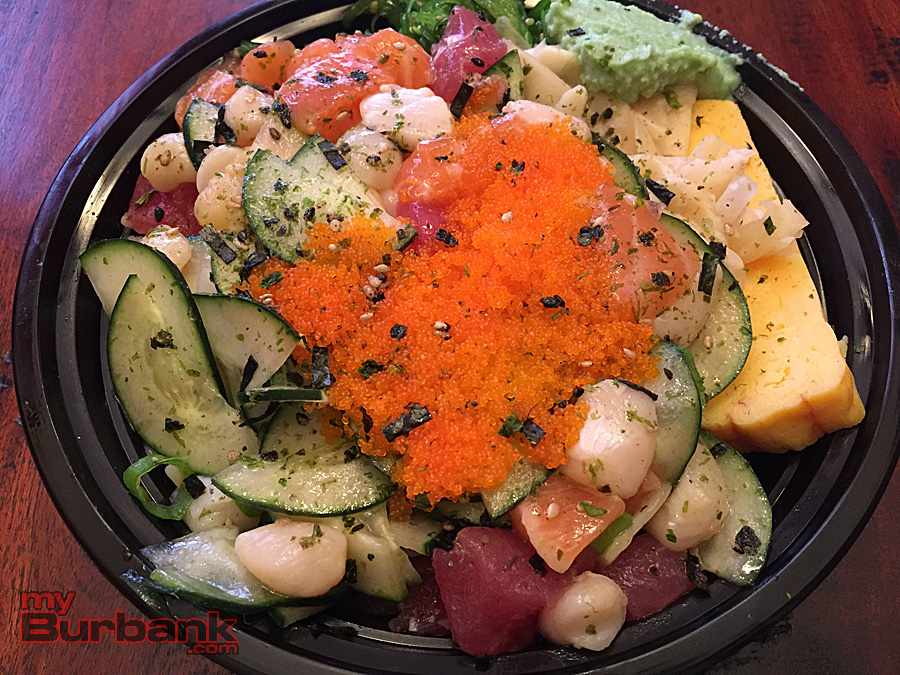 All About Poke Burbank's medium bowl piled high with raw bay scallops, tuna, salmon, tamago (sweet egg), flying fish roe and more. (Photo By Lisa Paredes)