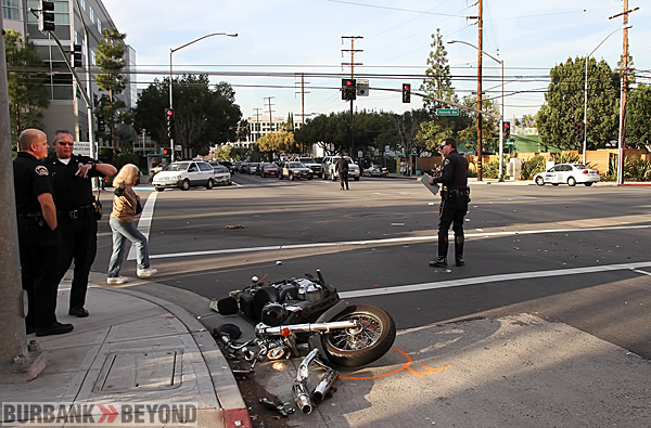 Motorcycle accident causes major injuries to rider, and closes intersection for a while. (Photo by Ross A. Benson)