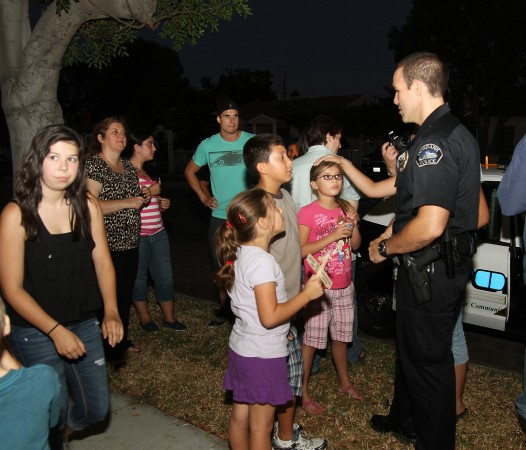 Burbank Police Officers along with Fire Fighters stopped by many of the National Night Out Block Party events. (Photo by Ross A. Benson)