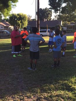 Burbank Dolphins listen attentively to coaches' instruction (Photo courtesy of Mike Graceffo)