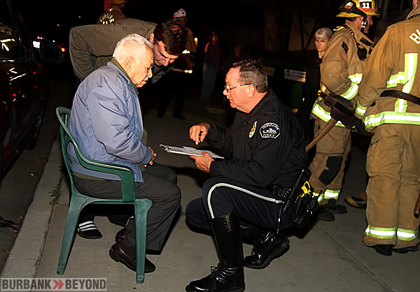 Burbank Police Traffic Officer Jim Peterson questions driver Aratek Murkelyan who accidentally ran into the wall in the building in which he lives.(Photo by Ross A. Benson)