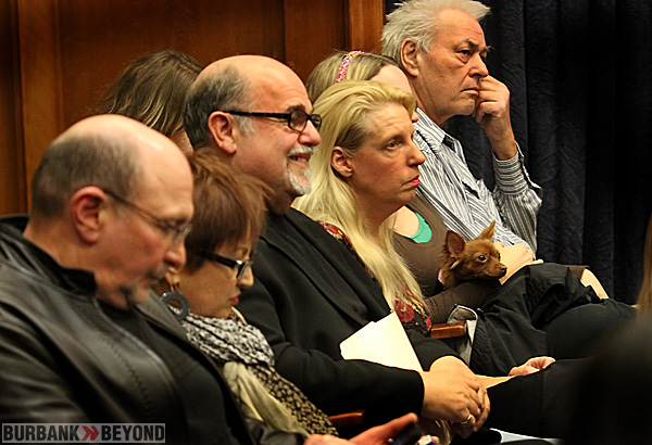 Center Peggy Woods Pets Owner Ira Lippman along with store Manager Jenny Dehl, listen to City Council debate. (Photo by Ross A. Benson)