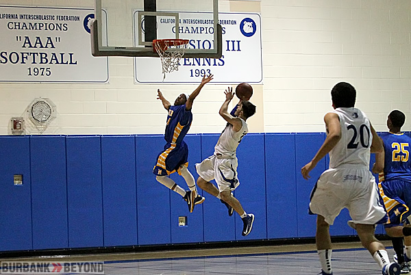 Richard Elmoyan scores two of his 16 points against Muir (Photo by Ross A. Benson)