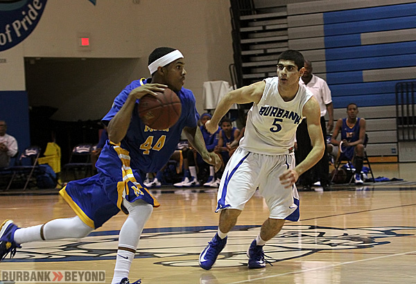 Andy Yanikyan of Burbank guards a Muir player closely (Photo by Ross A. Benson)