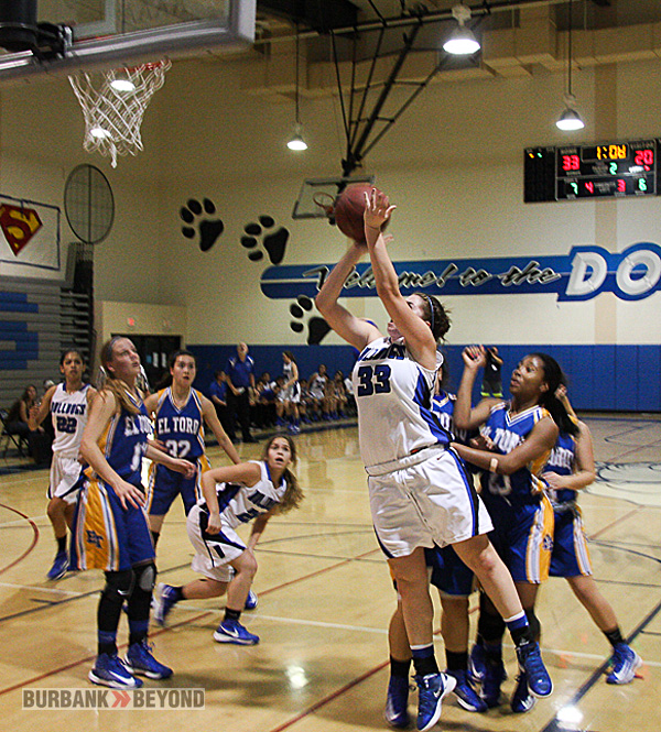 Courtney Seidler scores two of her 16 points (Photo by Dick Dornan)