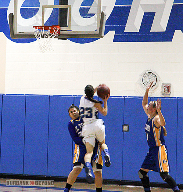 Ratiana Karapet of Burbank is called for a charge on this drive to the basket (Photo by Dick Dornan)