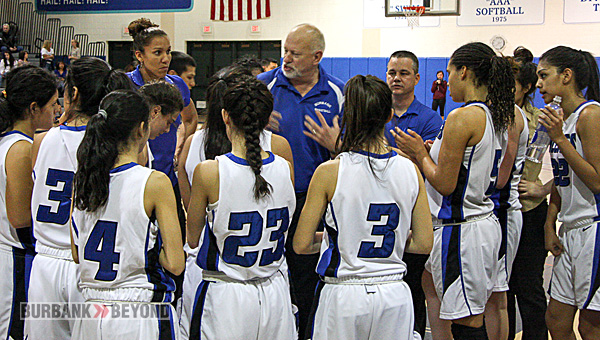 Coach Bruce Breeden talks to his team during a timeout (Photo by Dick Dornan)
