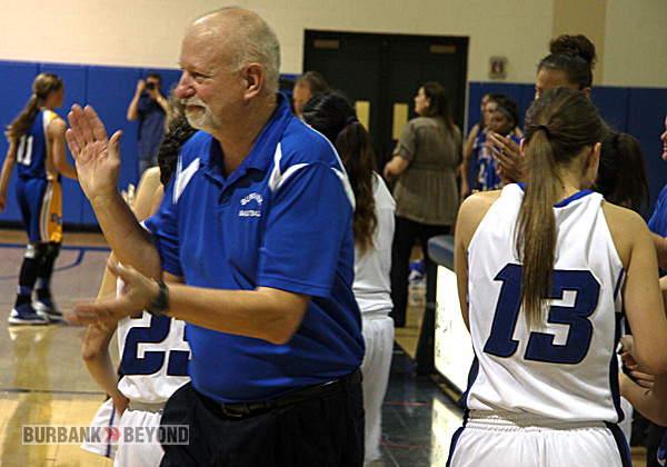 Coach Bruce Breeden celebrates the victory after the final buzzer sounds (Photo by Dick Dornan)