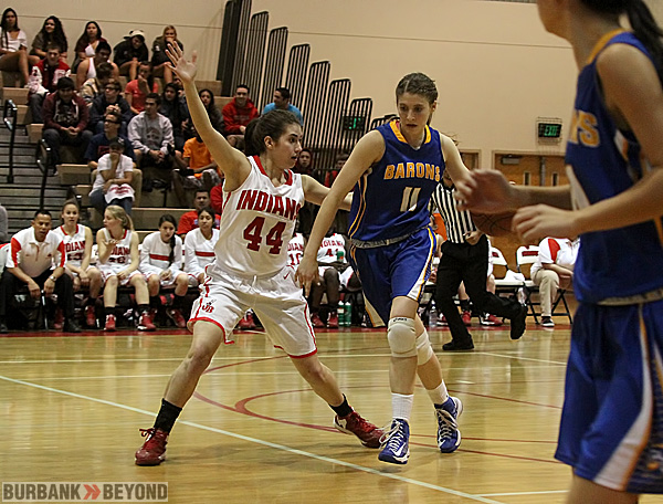 Bailee Trotta of Burroughs defends a Fountain Valley player (Photo by Ross A. Benson)