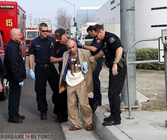 Burbank Police take thief suspect into custody after being identified by Von's Loss Prevention and other witnesses. Burbank Paramedics checked him out prior to transportation to jail. (Photo by Ross A. Benson)