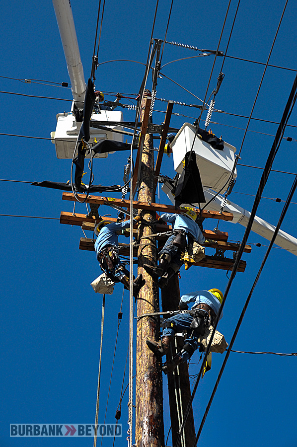 Burbank Water & Power crews work from all directions to transfer lines to the new pole  (Photo By Craig Sherwood)