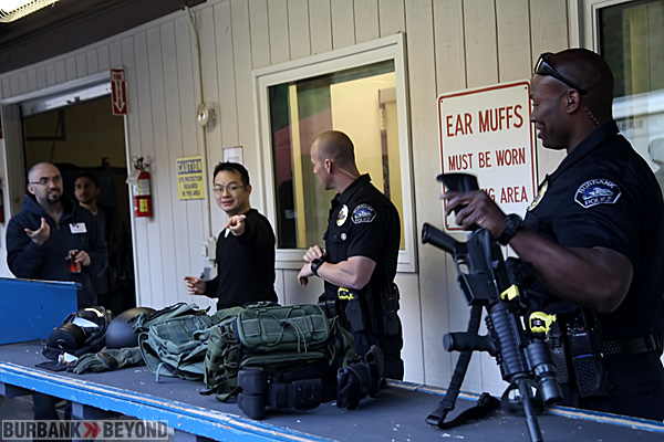 Members of Burbank's SWAT Team displays and answers question to a member of the class.(Photo by Ross A. Benson)