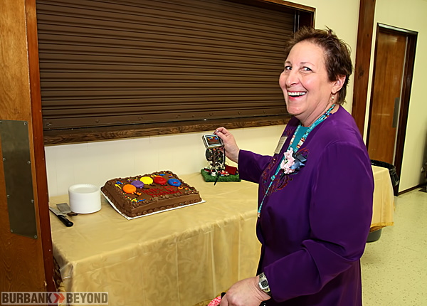 Long time Coordinating Council Member Janet Deil, records a pictures of the Special Cake celebrating the 80 Anniversary.(Photo by Ross A. Benson)