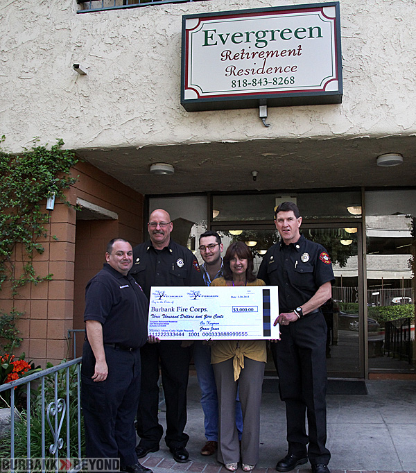 Avi Heyman and Grace Jones from Evergreen presented the Burbank Fire Chief Tom Lenahan and Battalion Chief Jeff Howe, along with Eric Bamgardner the check this past week. (Photo by Ross A. Benson)