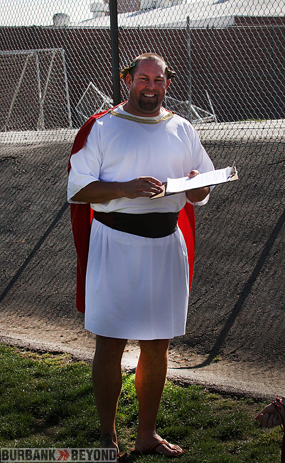 P.E. Coach Knoop donned the garb of the day. (Photo by Ross A. Benson)
