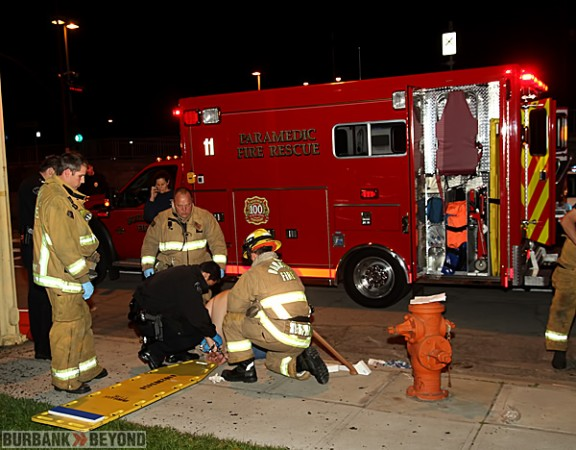 Burbank Paramedics prepare to transport this patient to Saint Joseph Medical Center, following an accident where he drove into a water main. (Photo by Ross A. Benson)