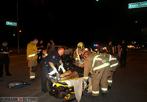 Burbank Fire Paramedics package up this motorcycle rider after he was involved in a accident at Victory Place & Empire Center. He was transported with moderate non life threatening injuries. (Photo by Ross A. Benson)