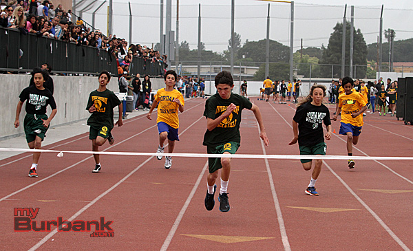 Jacob Calderon of Luther Burbank wins the 100m dash in the seventh grade division (Photo by Ross A. Benson)