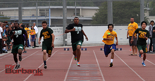 8th grade boys 100 meter dash (Photo by Ross A. Benson)