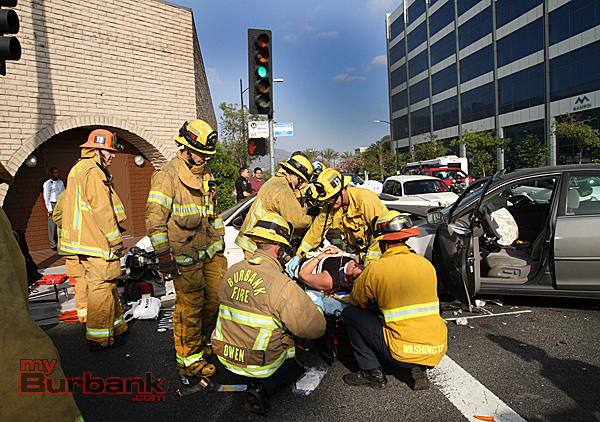 Burbank Fire Paramedics package up this patient for transport to a trauma center. (Photo by Ross A. Benson)